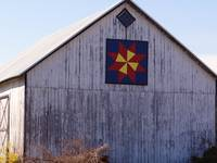 Old barn and pretty quilt pattern decoration