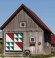 Large quilt pattern on small farm building