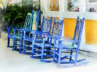 Row of Blue Rocking Chairs