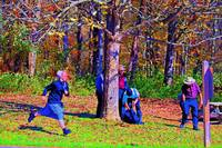 Girl Running with Boys by Trees