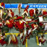"""Ferrari Pit Stop at the Singapore Grand Prix 2009"" by roadandtrackphotos"