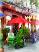 Outdoor Cafe with Red Umbrellas
