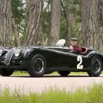 """Jaguar XK120 1950 with Phil Hill"" by roadandtrackphotos"