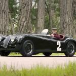 """Jaguar XK120 1950 with Phil Hill"" by roadandtrackphotos"