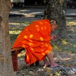 """Buddhist monk with iPod in Luang Prabang, Laos"" by veitschuetz"