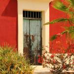 """Old Green Door and Red Adobe, Baja Mexico"" by RoupenBaker"