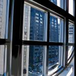 """Chicago Buildings Through Window"" by kphotos"