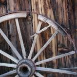 """Wagon Wheel Against Wall"" by burterwinphotography"
