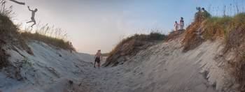 Jumping the Dunes at Dusk