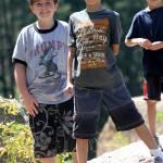 """Three little boys rock climbing"" by belinda_baardsen"