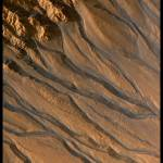 """Gullies on Mars"" by worldwidearchive"