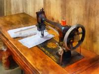 Sewing Machine With Orange Thread