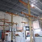 """Warehouse View of Demo Transformer Poles"" by TheElectricOrphanage"