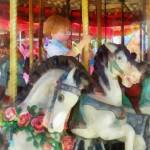 """Little Boy on Carousel"" by susansartgallery"
