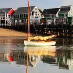 """Catboat and Cottage Wharf in Provincetown MA"" by RoupenBaker"