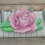 """pink rose on piano key"" by thuraya"
