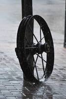 An Old Wheel In A Rain Shower