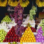 """Fruit stand in Indonesia"" by ingojez"