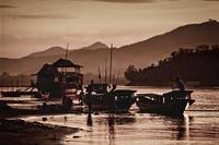 Boats on the bank of the Mekong in Laos