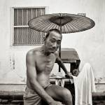 """Old Chinese trishaw driver in Penang, Malaysia"" by ingojez"