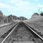 """Railroad Tracks Under Blue Sky"" by DedahStudios"