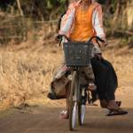 """Village Girls on a bicycle (Cambodia)"" by nabilkannan"