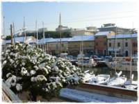 Harbour with snow in Cervia