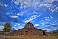 Clouds above a barn at the John Moulton Homestead