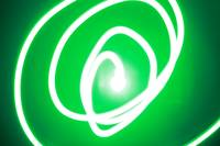 Spiraling green string of light