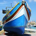 """Luzzu in Marsaxlokk Harbour"" by spottydog06"