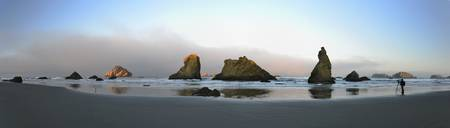 Panorama of Bandon Beach sea stacks at sunrise