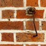 """Latch Hook on Brick Wall"" by swazoo"
