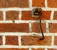 Latch Hook on Brick Wall