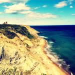 """Block Island Bluffs & Lighthouse"" by AmyHalpern"