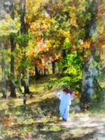 Little Girl Walking in Autumn Woods