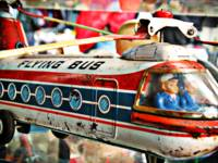 Vintage Flying bus tin toy