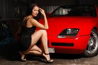 Pretty woman near the red car