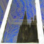 """Cologne Cathedral (Kölner Dom) mirrored in window"" by Triflour"