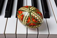 Painted Easter egg on piano keys