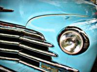 Blue Chevrolet truck headlight