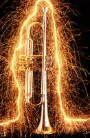 Trumpet outlined with sparks