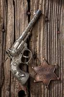 Toy gun and ranger badge