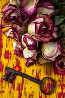 Dried pink roses and key