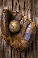 Old baseball mitt and ball