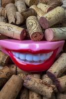 Smile among wine corks