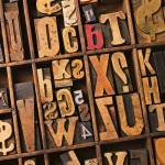 """Box of old wooden type setting blocks"" by photogarry"