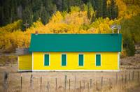 Old Yellow School House with Autumn Colors