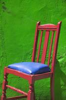 Red chair green wall