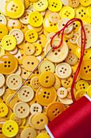 Red thread and yellow buttons