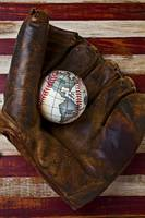 Baseball mitt with earth baseball